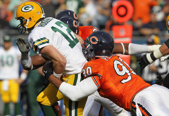 CHICAGO, IL - SEPTEMBER 25: Julius Peppers #90 of the Chicago Bears sacks Aaron Rodgers #12 of the Green Bay Packers at Soldier Field on September 25, 2011 in Chicago, Illinois. (Photo by Jonathan Daniel/Getty Images)