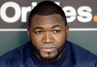 BALTIMORE, MD - SEPTEMBER 27:  David Ortiz #34 of the Boston Red Sox talks with the media before the start of the Red Sox game against the Baltimore Orioles at Oriole Park at Camden Yards on September 27, 2011 in Baltimore, Maryland.  (Photo by Rob Carr/G
