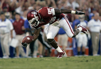 NORMAN, OK - SEPTEMBER 3:  Wide receiver Ryan Broyles #85 of the Oklahoma Sooners stumbles after a catch in the first half against the Tulsa Hurricanes on September 3, 2011 at Gaylord Family-Oklahoma Memorial Stadium in Norman, Oklahoma.  Oklahoma leads T