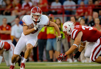 LINCOLN, NE - SEPTEMBER 10: Devon Wylie #7 of the Fresno State Bulldogs runs past Graham Stoddard #38 of the Nebraska Cornhuskers during their game at Memorial Stadium September 10, 2011 in Lincoln, Nebraska. Nebraska won 42-29.(Photo by Eric Francis/Gett