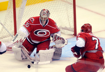 CHARLOTTE, NC - SEPTEMBER 25:  Goalie Cam Ward #30 of Carolina Hurricanes blocks a shot during the third period against the Winnipeg Jets during an NHL pre-season hockey game at the Time Warner Arena September 25, 2011 in Charlotte, North Carolina.  Carol