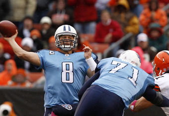 CLEVELAND, OH - OCTOBER 02:  Quarterback Matt Hasselbeck #8 of the Tennessee Titans throws a pass as he gets a blcok from Michael Roos #71 on linebacker Chris Gocong #51 of the Cleveland Browns at Cleveland Browns Stadium on October 2, 2011 in Cleveland,