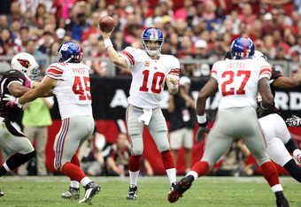 GLENDALE, AZ - OCTOBER 02:  Quarterback Eli Manning #10 of the New York Giants throws a pass during the NFL game against the Arizona Cardinals at the University of Phoenix Stadium on October 2, 2011 in Glendale, Arizona. The Giants defeated the Cardinals
