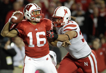 MADISON, WI - OCTOBER 01: Cameron Meredith #34 Nebraska Cornhuskers pressures Russell Wilson #16 of the Wisconsin Badgers  October 1, 2011 at Camp Randall stadium in Madison, Wisconsin. Wisconsin defeated Nebraska 48-17. (Photo by John Gress/Getty Images)