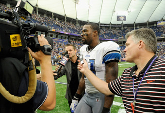 MINNEAPOLIS, MN - SEPTEMBER 25: Calvin Johnson #81 of the Detroit Lions speaks to the media as he walks off the field after a win against the Minnesota Vikings on September 25, 2011 at Hubert H. Humphrey Metrodome in Minneapolis, Minnesota. The Lions defe