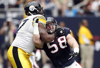 HOUSTON - OCTOBER 02:  Offensive tackle Marcus Gilbert #77 of the Pittsburgh Steelers and Brooks Reed #58 of the Houston Texans lock up during first half action at Reliant Stadium on October 2, 2011 in Houston, Texas.  (Photo by Bob Levey/Getty Images)