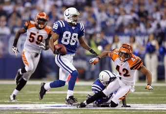 INDIANAPOLIS - DECEMBER 07:  Marvin Harrison #88 of the Indianapolis Colts runs for yards after the catch on a 67-yard reception in the third quarter against Chris Crocker #42 and Brandon Johnson #59 of the Cincinnati Bengals at Lucas Oil Stadium on Decem