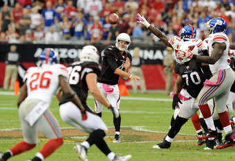 GLENDALE, AZ - OCTOBER 02:  Kevin Kolb #4 of the Arizona Cardinals throws a pass down field against the New York Giants at University of Phoenix Stadium on October 2, 2011 in Glendale, Arizona. New York won 31-27.   (Photo by Norm Hall/Getty Images)