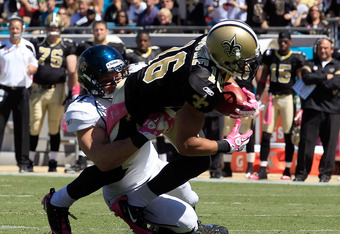 JACKSONVILLE, FL - OCTOBER 02:  Paul Posluszny #51 of the Jacksonville Jaguars tackles  Lance Moore #16 of the New Orleans Saints during a game at EverBank Field on October 2, 2011 in Jacksonville, Florida.  (Photo by Sam Greenwood/Getty Images)