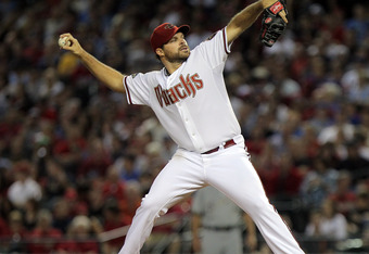 PHOENIX, AZ - OCTOBER 04:  Josh Collmenter #55 of the Arizona Diamondbacks pitches in the seventh inning against the Milwaukee Brewers in Game Three of the National League Division Series at Chase Field on October 4, 2011 in Phoenix, Arizona.  (Photo by D
