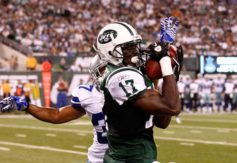 EAST RUTHERFORD, NJ - SEPTEMBER 11:  Plaxico Burress #17 of the New York Jets catches a 26-yard touchdown in the fourth quarter against Bryan McCann #37 of the Dallas Cowboys during their NFL Season Opening Game at MetLife Stadium on September 11, 2011 in