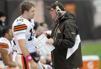 CLEVELAND, OH - OCTOBER 2: Quarterback Colt McCoy #12 listens to quarterbacks coach Mark Whipple of the Cleveland Browns during the fourth quarter against the Tennessee Titans at Cleveland Browns Stadium on October 2, 2011 in Cleveland, Ohio. The Titans d