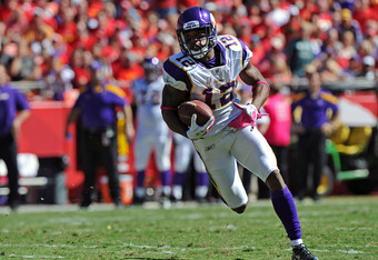 KANSAS CITY, MO - OCTOBER 02:  Wide receiver Percy Harvin #12 of the Minnesota Vikings scrambles for a first down against the Kansas City Chiefs during the second quarter on October 2, 2011 at Arrowhead Stadium in Kansas City, Missouri.  (Photo by Peter A