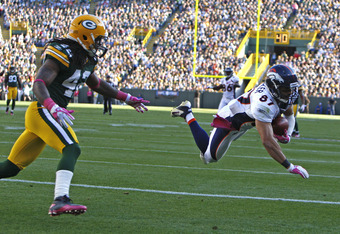 GREEN BAY, WI - OCTOBER 2: Eric Decker #87 of the Denver Broncos catches a pass for a touchdown against Morgan Burnett #42 of the Green Bay Packers at Lambeau Field on October 2, 2011 in Green Bay, Wisconsin.  (Photo by Matt Ludtke /Getty Images)