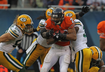 CHICAGO, IL - SEPTEMBER 25: Matt Forte #22 of the Chicago Bears is tackled by (L-R) Clay Matthews #52, Erik Walden #93, Sam Shields #37 and Morgan Burnett #42 of the Green Bay Packers at Soldier Field on September 25, 2011 in Chicago, Illinois. The Packer
