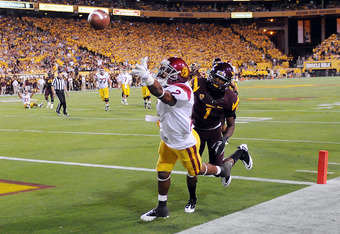 TEMPE, AZ - SEPTEMBER 24:  Robert Woods #2 of the University of Southern California Trojans can't come up with the ball while being defended by Deveron Carr #1 of the Arizona State Sun Devils at Sun Devil Stadium on September 24, 2011 in Tempe, Arizona.