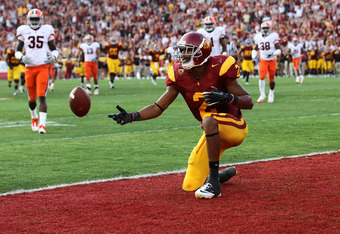 LOS ANGELES - SEPTEMBER 17:   Robert Woods #2 of the USC Trojans flips the ball after scoring on a 31 yard touchdown catch in the second quarter against the Syracuse Orangemen at the Los Angeles Memorial Coliseum on September 17, 2011 in Los Angeles, Cali