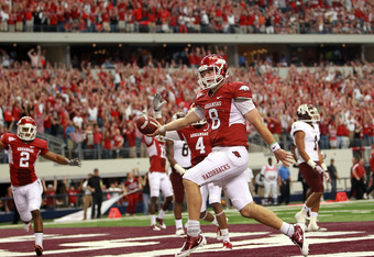 ARLINGTON, TX - OCTOBER 01:  Quarterback Tyler Wilson #8 of the Arkansas Razorbacks scores a two point conversion against the Texas A&M Aggies at Cowboys Stadium on October 1, 2011 in Arlington, Texas.  (Photo by Ronald Martinez/Getty Images)