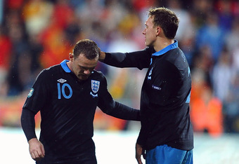 PODGORICA, MONTENEGRO - OCTOBER 07:  Wayne Rooney of England shows his disappointment after being sent off during the UEFA EURO 2012 group G qualifier between Montenegro and England at the City Stadium on October 7, 2011 in Podgorica, Montenegro.  (Photo