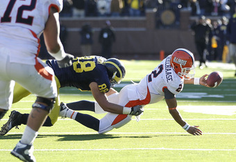 ANN ARBOR, MI - NOVEMBER 06:  Nathan Scheelhaase #2 of the Illinios Fighting Illini is tackled by Craig Roh #88 of the Michigan Wolverines as he tries a desperation pass in triple overtime to end the game at Michigan Stadium on November 6, 2010 in Ann Arb
