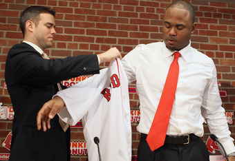 BOSTON, MA - DECEMBER 11:  Theo Epstein (L), general manager of the Boston Red Sox, welcomes Carl Crawford to the team during a press conference to announce Crawford's signing on December 11,  2010 at the Fenway Park in Boston, Massachusetts.  (Photo by E