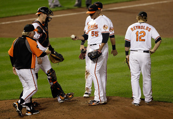 BALTIMORE, MD - SEPTEMBER 28: Manager Buck Showalter (L) removes starting pitcher Alfredo Simon #55 of the Baltimore Orioles from the game during the fifth inning against the Boston Red Sox at Oriole Park at Camden Yards on September 28, 2011 in Baltimore