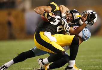 PITTSBURGH - SEPTEMBER 11:   Hines Ward #86 of the Pittsburgh Steelers is pulled down by Cortland Finnegan #31 of the Tennessee Titans on September 11, 2009 at Heinz Field in Pittsburgh, Pennsylvania. The Steelers defeated the Titans 13-10 in overtime.  (