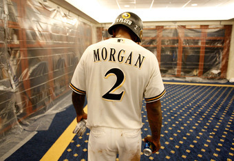 MILWAUKEE, WI - OCTOBER 07:  Nyjer Morgan #2 of the Milwaukee Brewers walks around the clubhouse wearing a helmet with the name 'T Plush' on the back following their win against the Arizona Diamondbacks in Game Five of the National League Division Series
