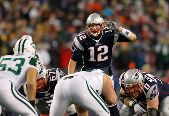 FOXBORO, MA - DECEMBER 06:  Tom Brady #12 of the New England Patriots gestures at the line of scrimmage against the New York Jets at Gillette Stadium on December 6, 2010 in Foxboro, Massachusetts. The Patriots won 45-3. (Photo by Jim Rogash/Getty Images)