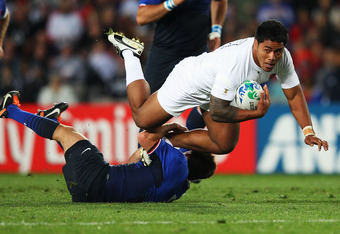 AUCKLAND, NEW ZEALAND - OCTOBER 08:  Manu Tuilagi of England is tackled by Dimitri Yachvili during quarter final two of the 2011 IRB Rugby World Cup between England and France at Eden Park on October 8, 2011 in Auckland, New Zealand.  (Photo by David Roge