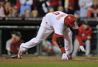 PHILADELPHIA, PA - OCTOBER 07:  Ryan Howard #6 of the Philadelphia Phillies stumbles as he runs out of the box on his ground out for the final out of the game as they lost 1-0 against the St. Louis Cardinals during Game Five of the National League Divisio