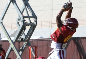 Freshman George Farmer leaps for a great catch. He is changing to RB and may play against Cal with his 4.3 speed.
