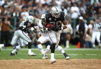 OAKLAND, CA - SEPTEMBER 25:  Darren McFadden #20 of the Oakland Raiders runs against the New York Jets at O.co Coliseum on September 25, 2011 in Oakland, California.  (Photo by Jed Jacobsohn/Getty Images)