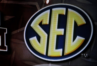 COLLEGE STATION, TX - SEPTEMBER 26:  The Southeastern Conference logo and the Texas A&M Aggies logo is seen on a screen during a press conference for Texas A&M accepting an invitation to join the Southeastern Conference on September 26, 2011 in College St