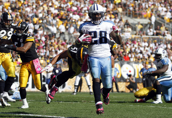 PITTSBURGH, PA - OCTOBER 9:   Chris Johnson #28 of the Tennessee Titans runs into the end zone for a touchdown against the Pittsburgh Steelers during the game on October 9, 2011 at Heinz Field in Pittsburgh, Pennsylvania.  The Steelers defeated the Titans