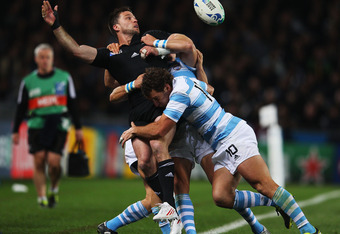 AUCKLAND, NEW ZEALAND - OCTOBER 09:  Cory Jane of the All Blacks is tackled by Santiago Fernandez of Argentina during quarter final four of the 2011 IRB Rugby World Cup between New Zealand and Argentina at Eden Park on October 9, 2011 in Auckland, New Zea