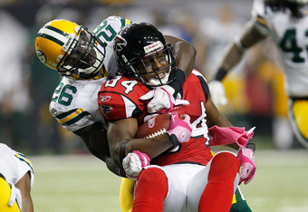 ATLANTA, GA - OCTOBER 09:  Roddy White #84 of the Atlanta Falcons is taken down by Charlie Peprah #26 of the Green Bay Packers at Georgia Dome on October 9, 2011 in Atlanta, Georgia.  (Photo by Kevin C. Cox/Getty Images)