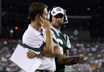 PHILADELPHIA - SEPTEMBER 02: Mark Sanchez #6 and offensive coordinator Brian Schottenheimer of the New York Jets look on during a preseason game against the Philadelphia Eagles at Lincoln Financial Field on September 2, 2010 in Philadelphia, Pennsylvania.