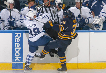 BUFFALO, NY - SEPTEMBER 24: Patrick Kaleta #36 of the Buffalo Sabres collides with Matt Frattin #39 of the Toronto Maple Leafs at First Niagara Center on September 24, 2011 in Buffalo, New York.  (Photo by Rick Stewart/Getty Images)