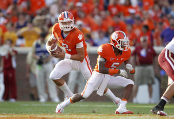 CLEMSON, SC - OCTOBER 8: Cole Stoudt #8 of the Clemson Tigers fakes a handoff to Mike Bellamy #5 during the game against the Boston College Eagles at Memorial Stadium on October 8, 2011 in Clemson, South Carolina. Clemson won 36-14. (Photo by Joe Robbins/