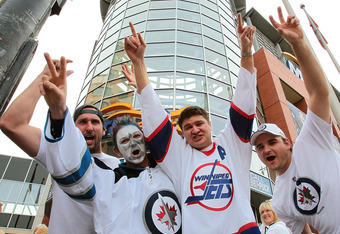 WINNIPEG, CANADA - OCTOBER 9: Winnipeg Jets fans (L-R) Andrew Sinclair, Eric Hogue, Kyle MacKay and Tyler Contant make their way to the MTS Centre before the Winnipeg Jets game against the Montreal Canadiens for NHL action at the MTS Centre on October 9,