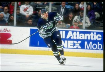 13 Feb 1997:  Leftwinger Kent Manderville of the Hartford Whalers moves down the ice during a game against the New Jersey Devils at the Continental Airlines Arena in East Rutherford, New Jersey.  The Devils won the game, 4-0. Mandatory Credit: Al Bello  /