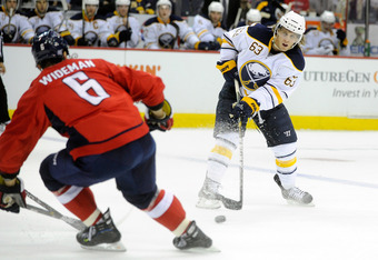 WASHINGTON, DC - SEPTEMBER 30:  Tyler Ennis #63 of the Buffalo Sabres shoots the puck against the Washington Capitals at the Verizon Center on September 30, 2011 in Washington, DC.  (Photo by Greg Fiume/Getty Images)