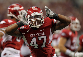 ARLINGTON, TX - OCTOBER 01:  Matt Marshall #47 of the Arkansas Razorbacks celebrates a tackle against the Texas A&M Aggies at Cowboys Stadium on October 1, 2011 in Arlington, Texas.  (Photo by Ronald Martinez/Getty Images)