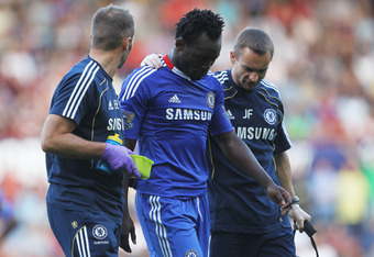 LONDON, ENGLAND - SEPTEMBER 11:  Michael Essien of Chelsea is given treatment during the Barclays Premier League match between West Ham United and Chelsea at the Boleyn Ground on September 11, 2010 in London, England.  (Photo by Hamish Blair/Getty Images)