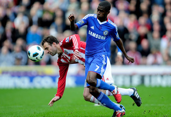 STOKE ON TRENT, ENGLAND - APRIL 02:  Ramires of Chelsea tangles with Danny Higginbotham of Stoke City during the Barclays Premier League match between Stoke City and Chelsea at the Britannia Stadium on April 2, 2011 in Stoke on Trent, England.  (Photo by