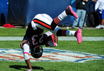 CHICAGO, IL - OCTOBER 2: Devin Hester #23 of the Chicago Bears celebrates as he scores a touchdown on a 69 yard punt return against the Carolina Panthers at Soldier Field on October 2, 2011 in Chicago, Illinois. Hester broke the NFL record with his 11th c