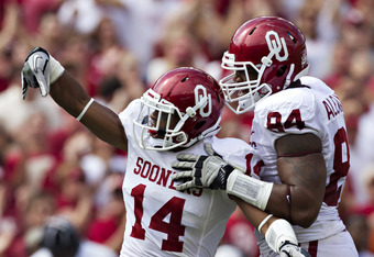 DALLAS, TX - OCTOBER 8:   Aaron Colvin #15 of the Oklahoma Sooners  celebrates after a big play against the Texas Longhorns at the Cotton Bowl on October 8, 2011 in Dallas, Texas.  The Sooners defeated the Longhorns 55 to 17.  (Photo by Wesley Hitt/Getty