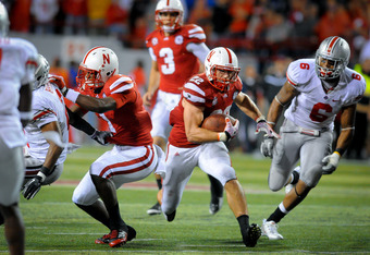 LINCOLN, NE - OCTOBER 8: Running back Rex Burkhead #22 of the Nebraska Cornhuskers follows his blockers during their game against the Ohio State Buckeyes at Memorial Stadium October 8, 2011 in Lincoln, Nebraska. Nebraska defeated Ohio State 34-27. (Photo