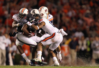 COLUMBIA, SC - OCTOBER 01:  Alshon Jeffery #1 of the South Carolina Gamecocks is tackled by the Auburn Tigers defense during their game at Williams-Brice Stadium on October 1, 2011 in Columbia, South Carolina.  (Photo by Streeter Lecka/Getty Images)
